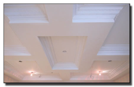 Competion of square dome with ornate pattern in crown molding